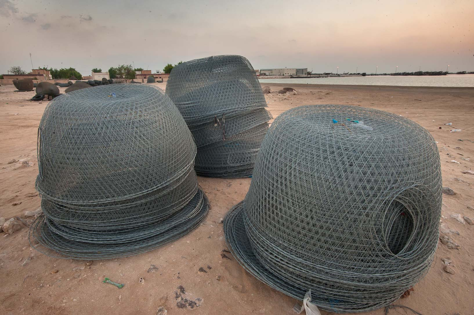 Stacked domed wire fish traps (gargoor). Al Wakra, Qatar