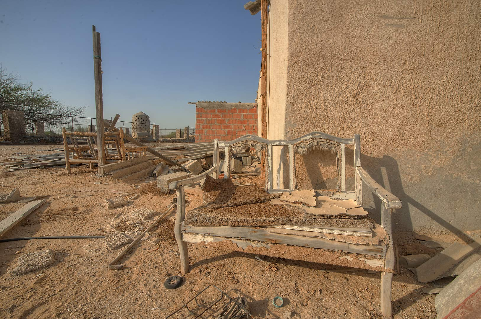 Traditional dikka (raised seat) in a village of...of Ras Laffan Farms. Northern Qatar