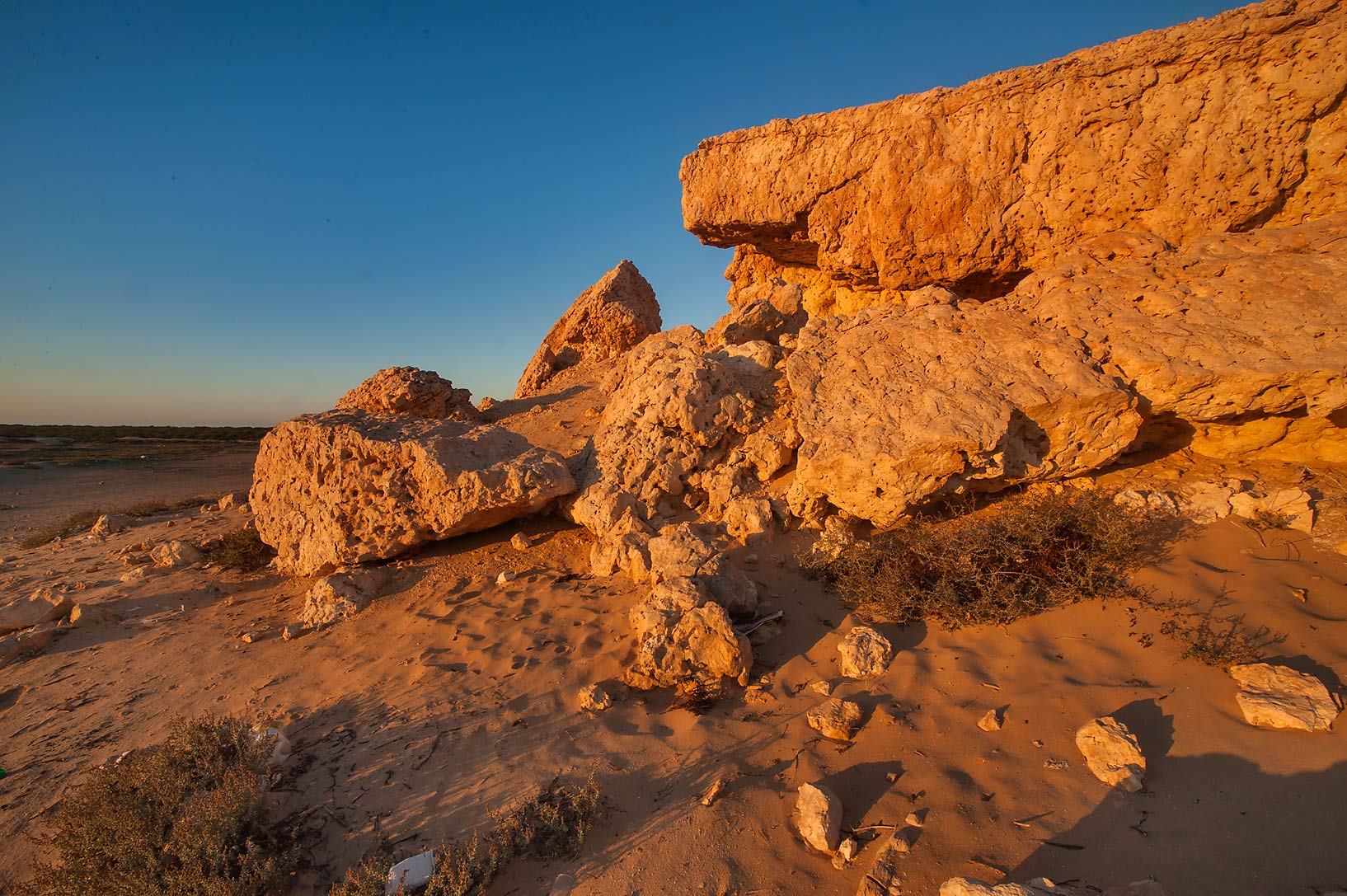 Cliffs of Purple Island (Jazirat Bin Ghanim) at sunrise. Al Khor, Qatar