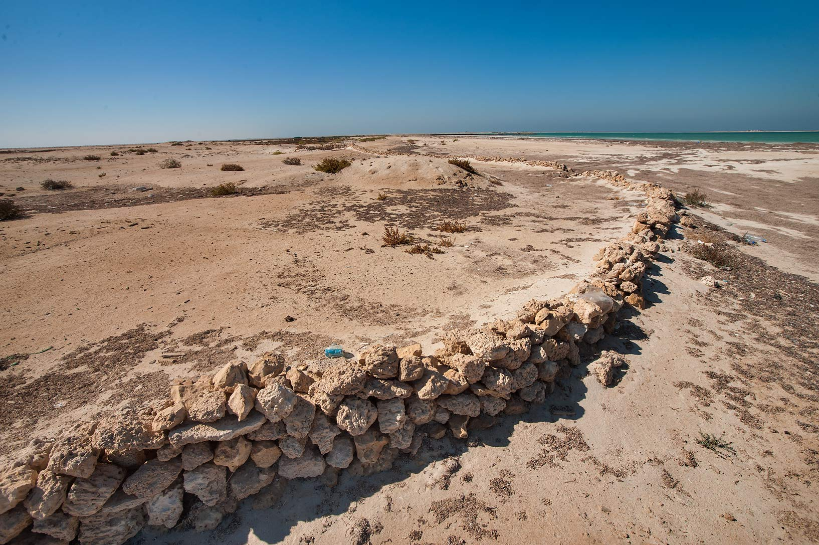 Ancient ingenious intertidal stone fish traps on...archeological site. Northern Qatar