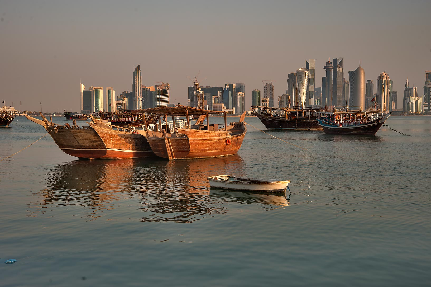 Moored dhow fishing boats, view from Corniche. Doha, Qatar