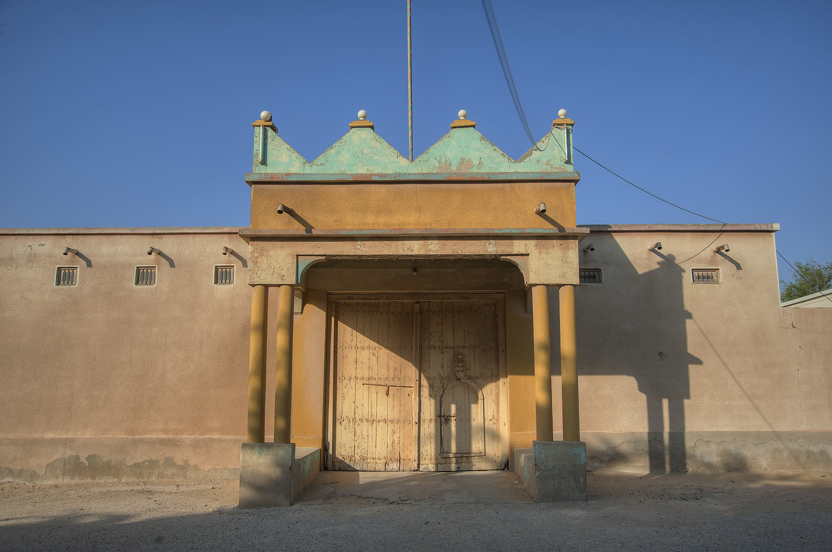 Decorated gate near the entrance of Trainah. Southern Qatar