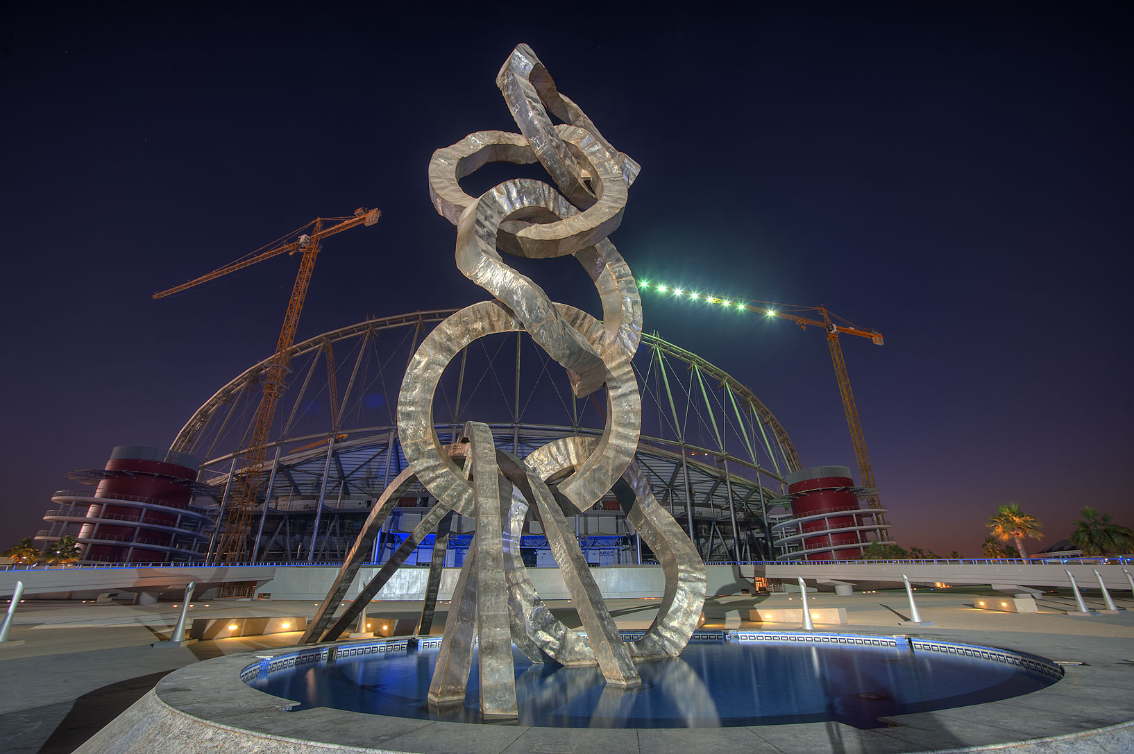 Olympic rings sculpture and Khalifa Stadium in Aspire Zone. Doha, Qatar