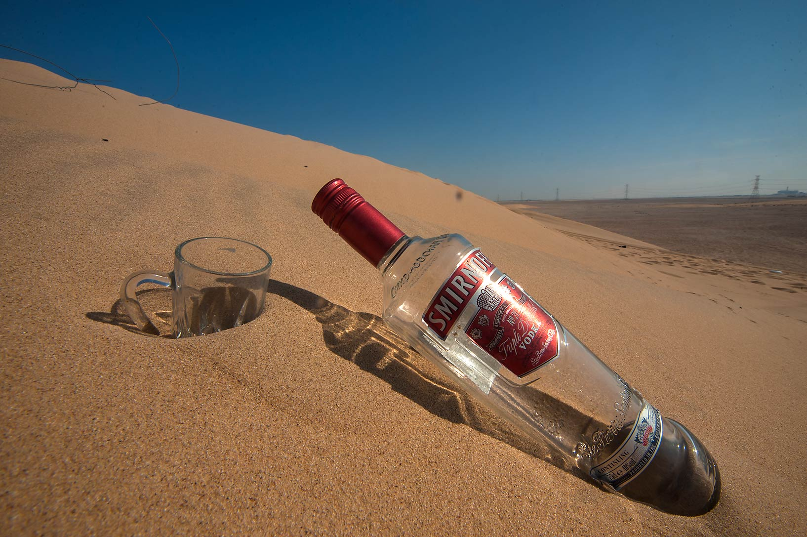 Littered Singing Sand Dunes near Mesaieed. Qatar