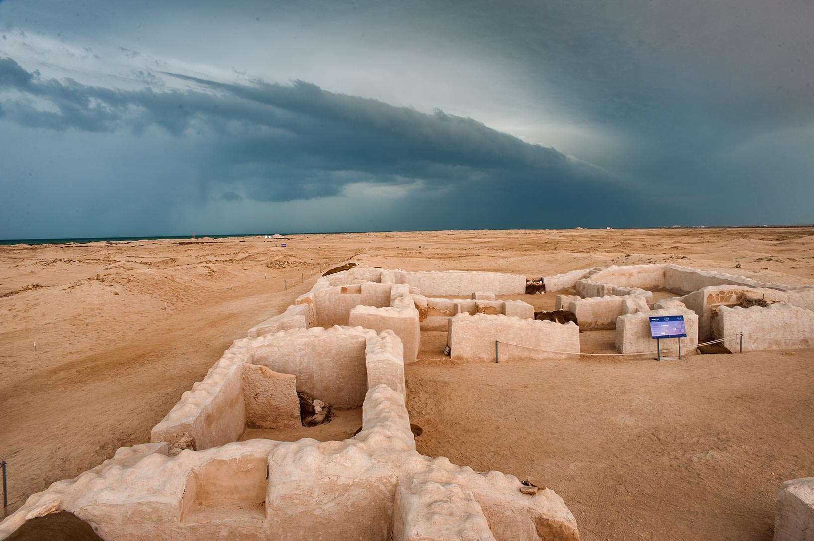 Thunderstorm clouds along approaching cold front...archeological site. Northern Qatar