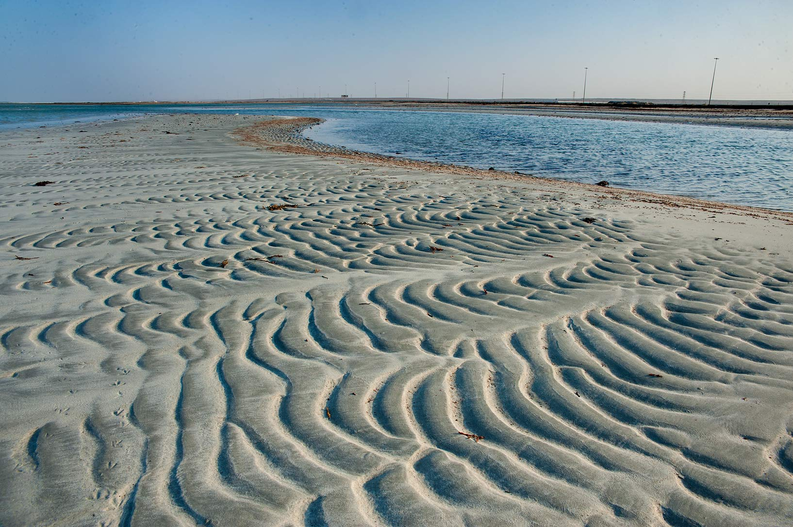 Sand ripples on a beach in Abu Samra, near the border. Southern Qatar