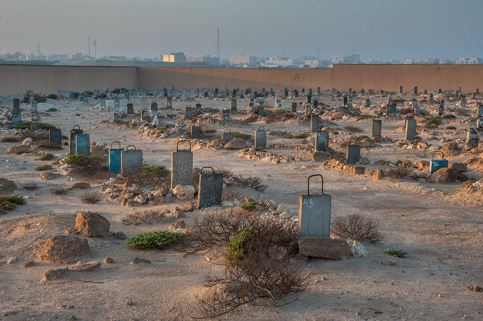 Concrete tombstones of Al Khor Cemetery. North from Al Khor, Qatar