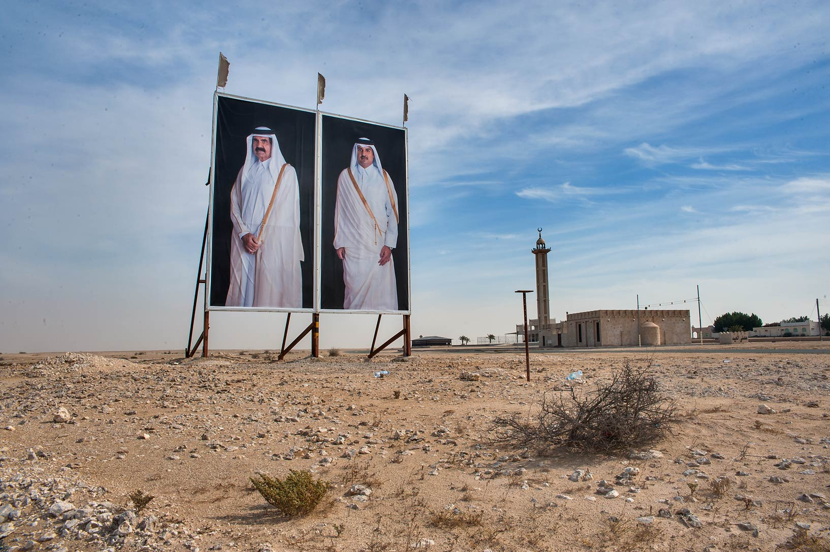 Portraits of emir Tamim and his father Hamad bin...of Abu Sidra in north-western Qatar
