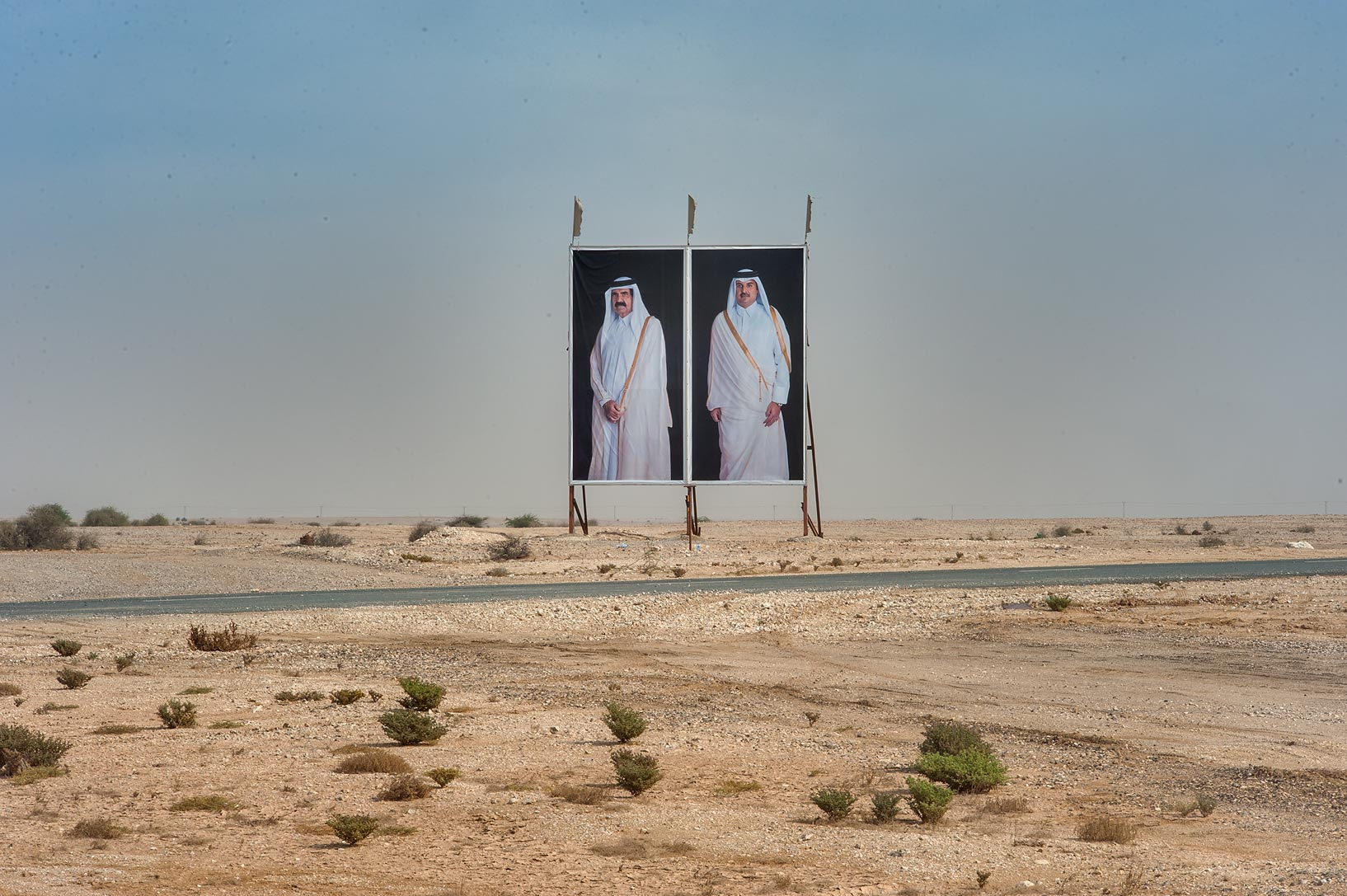 Portraits of emir Tamim and his father Hamad bin...near Abu Sidra in north-western Qatar