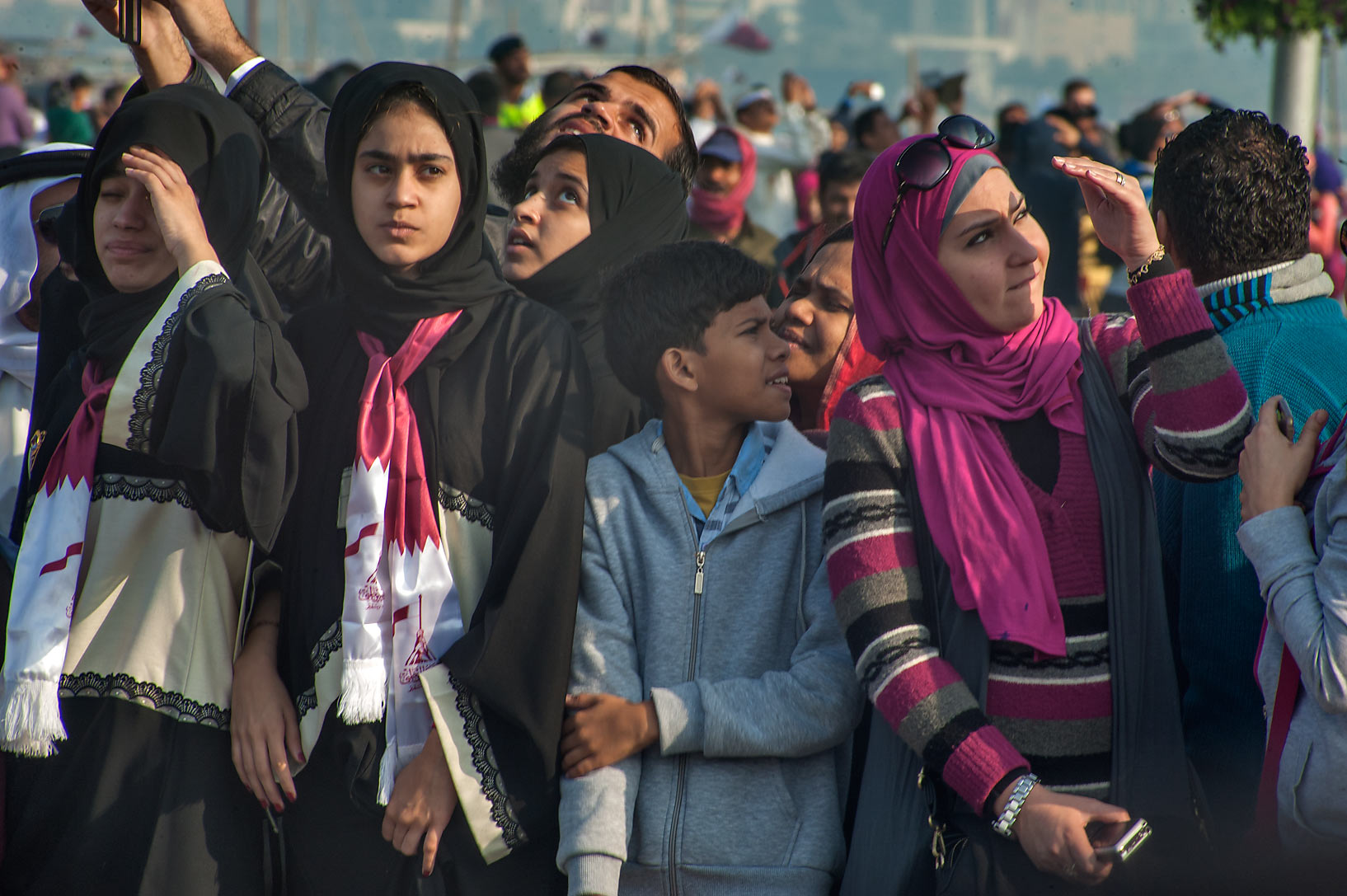 Spectators watching American airplanes and air...Day parade on Corniche. Doha, Qatar
