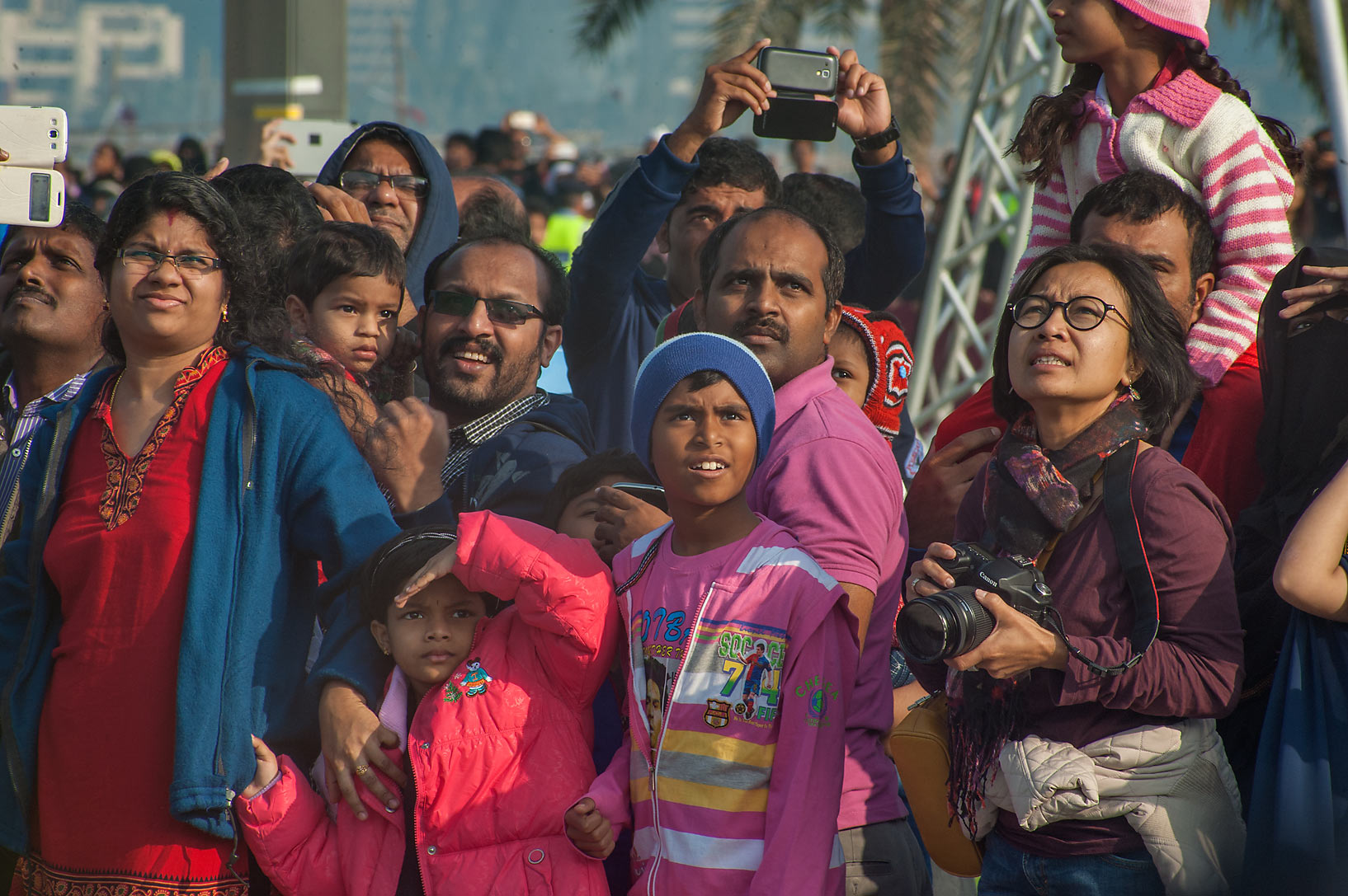 Spectators watching air force landing at National Day parade on Corniche. Doha, Qatar