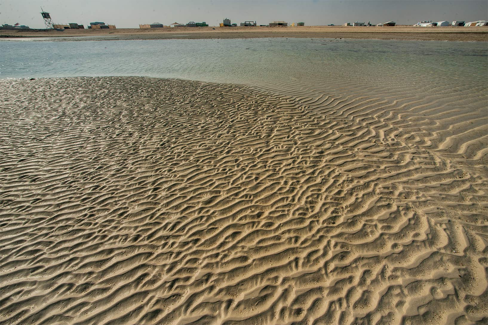 Sand ripples on a beach in Marouna. Northern Qatar