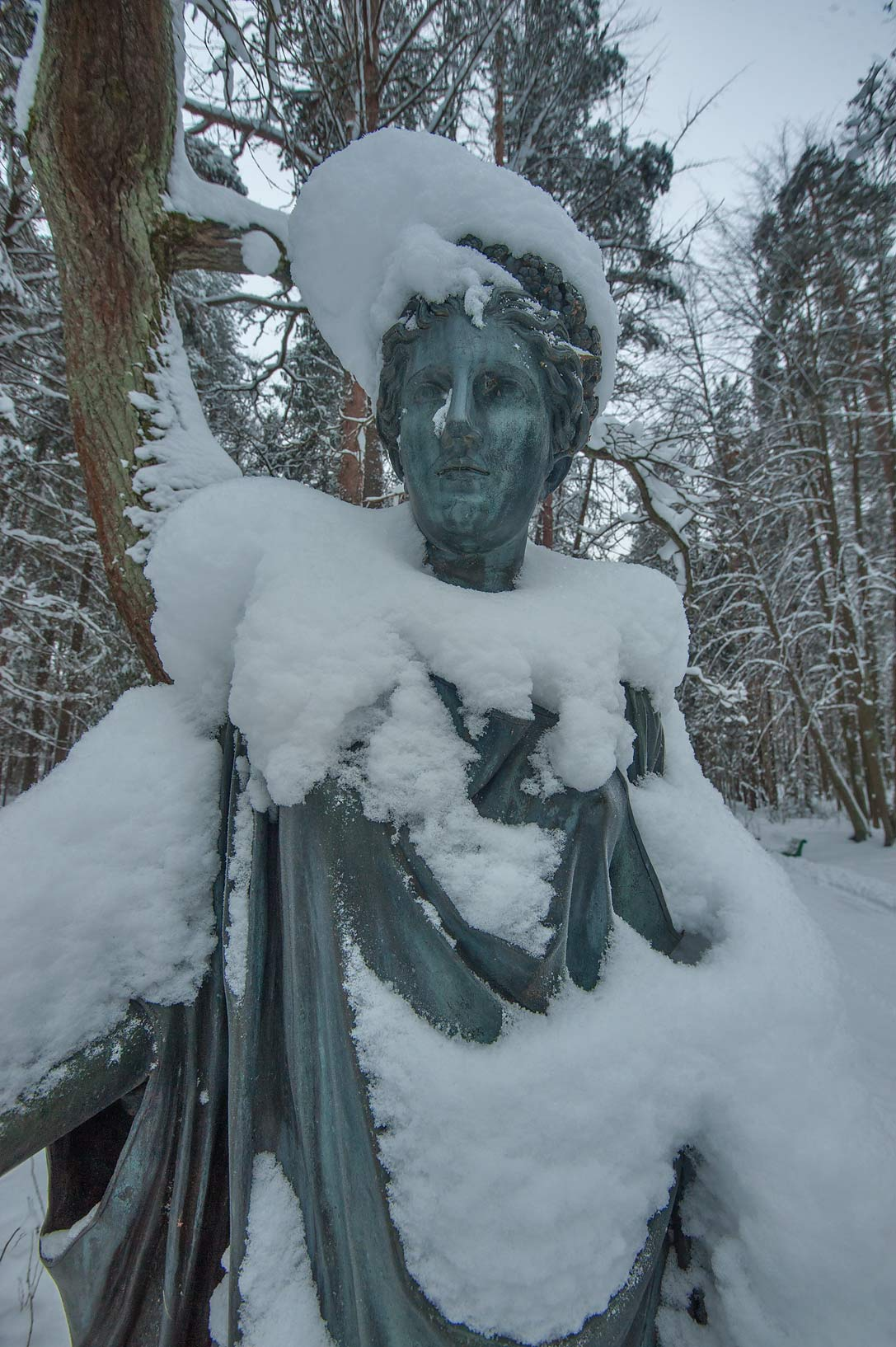 Sculpture of a muse in snow on Twelve Paths...a suburb of St.Petersburg, Russia