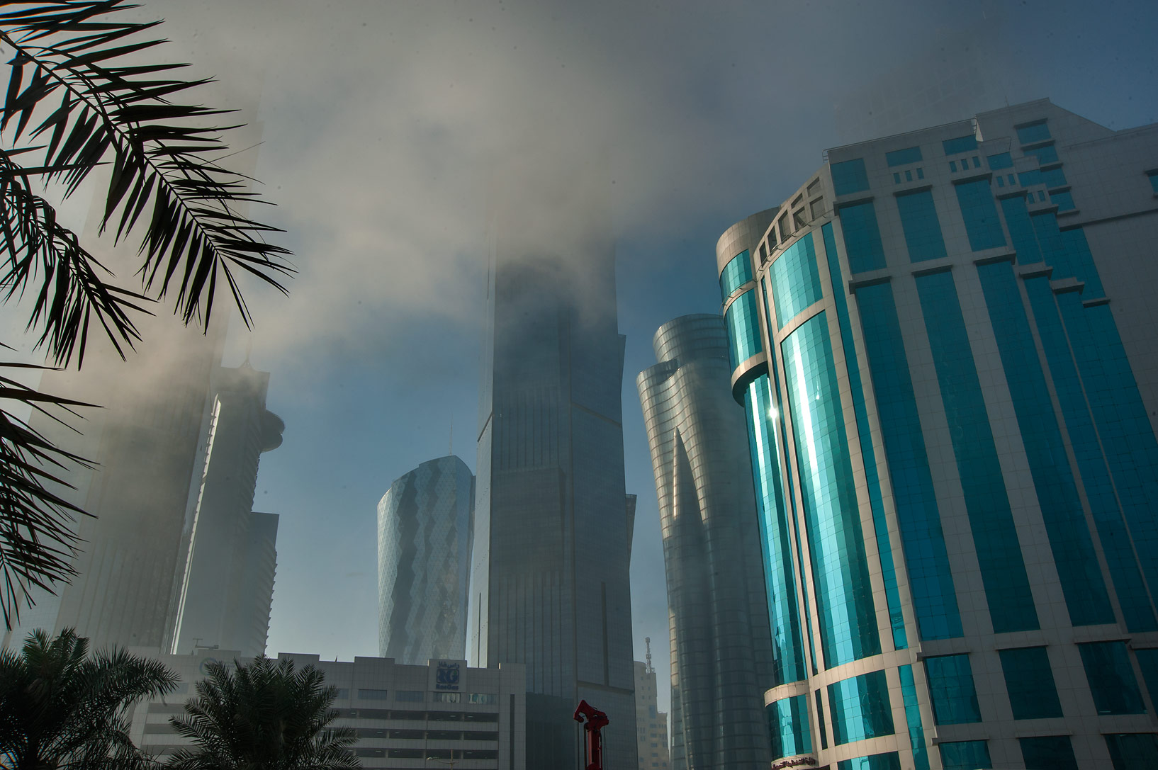 View of Al Taawon St. in West Bay at foggy morning. Doha, Qatar