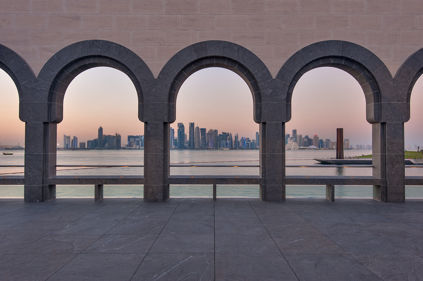 View of West Bay from courtyard of Museum of Islamic Art at evening. Doha, Qatar