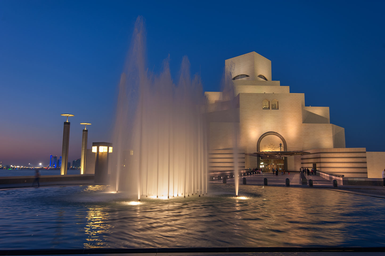 Water fountain and pool of Museum of Islamic Art at evening. Doha, Qatar