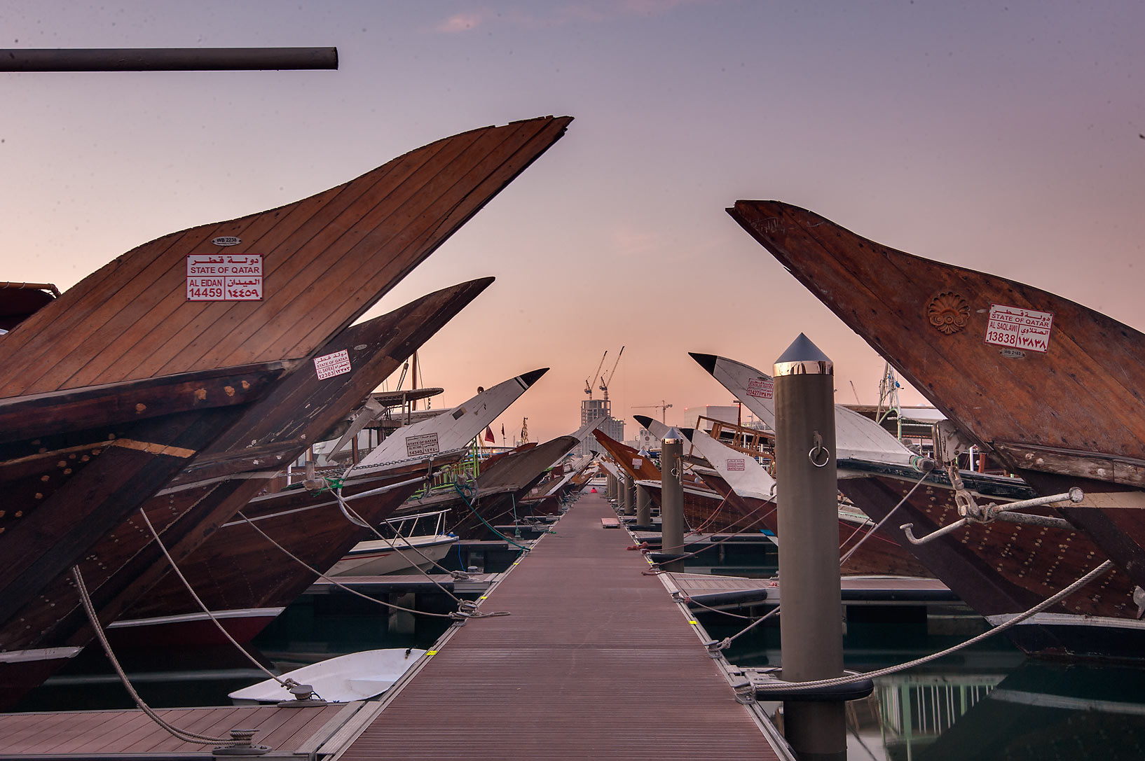 Dhow fishing boats docked on a pier at morning. Doha, Qatar
