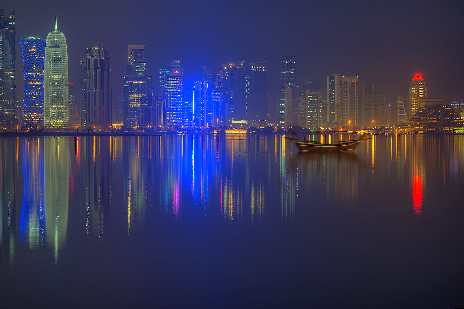 Reflections of West Bay towers from Corniche promenade. Doha, Qatar