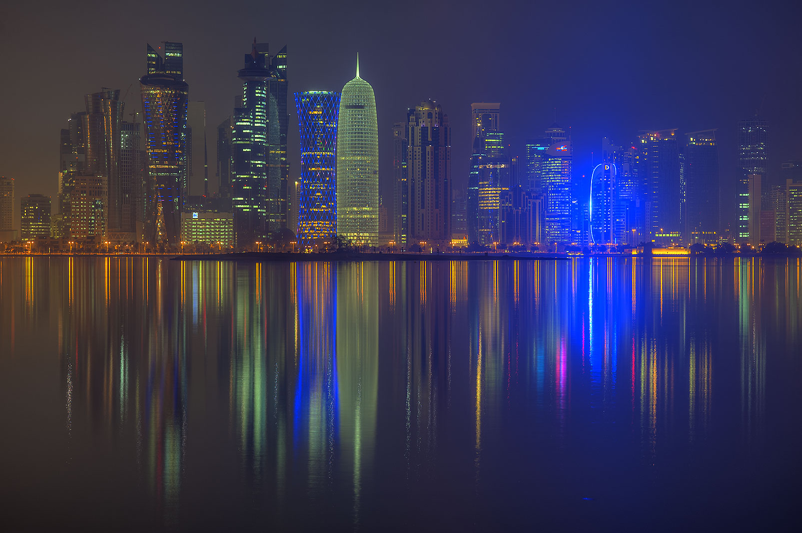 Lights of West Bay towers from Corniche promenade. Doha, Qatar