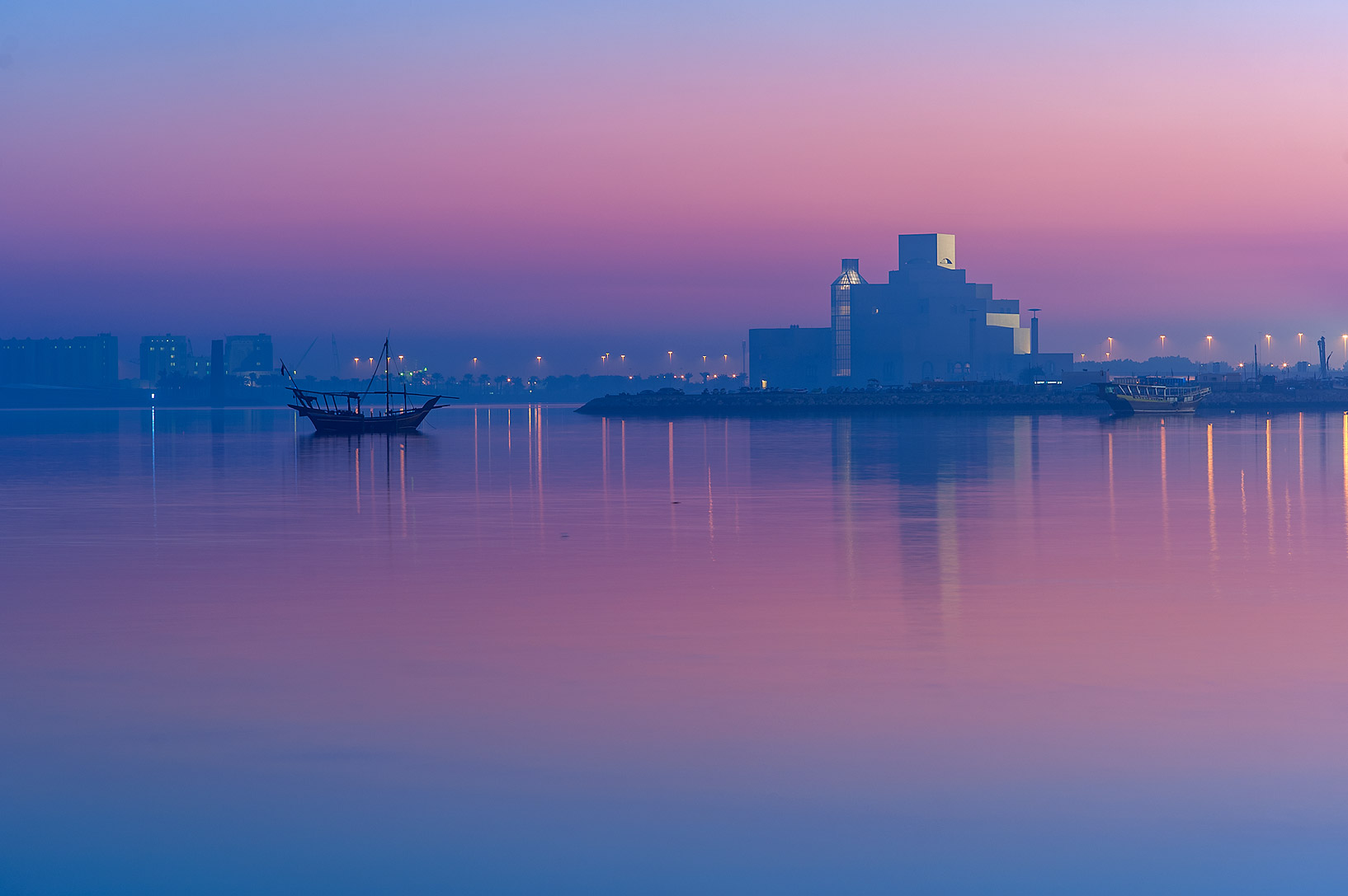 Museum of Islamic Art from Corniche promenade at dusk. Doha, Qatar