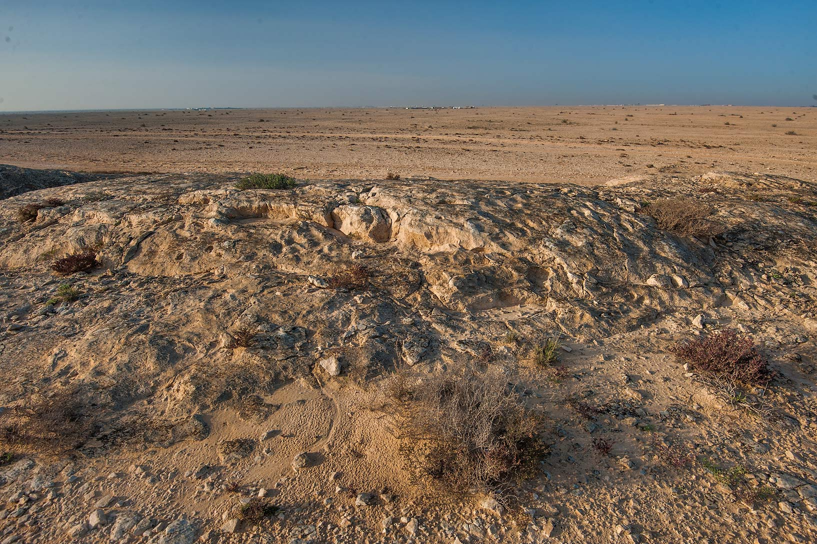 View of desert from rocky ridge of Jebel Fuwairit. Qatar