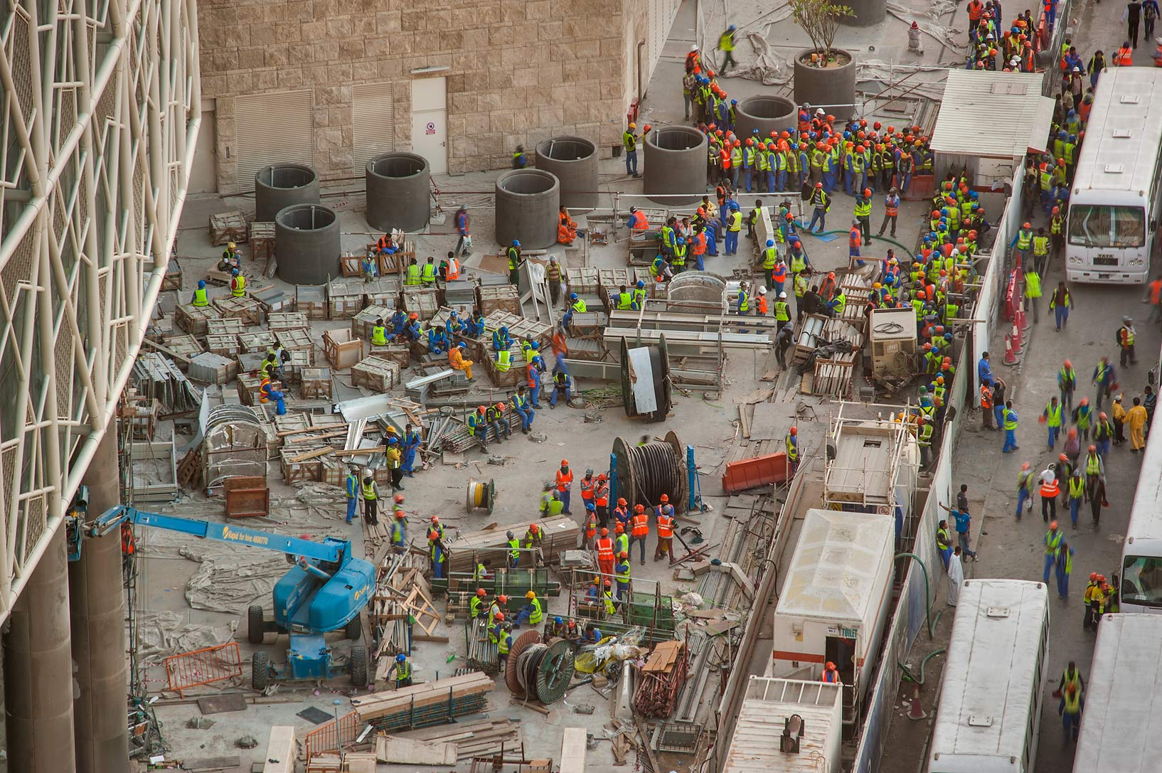 Gathering of workers on construction of Qatar...1-2244 of Ezdan Hotel. Doha, Qatar