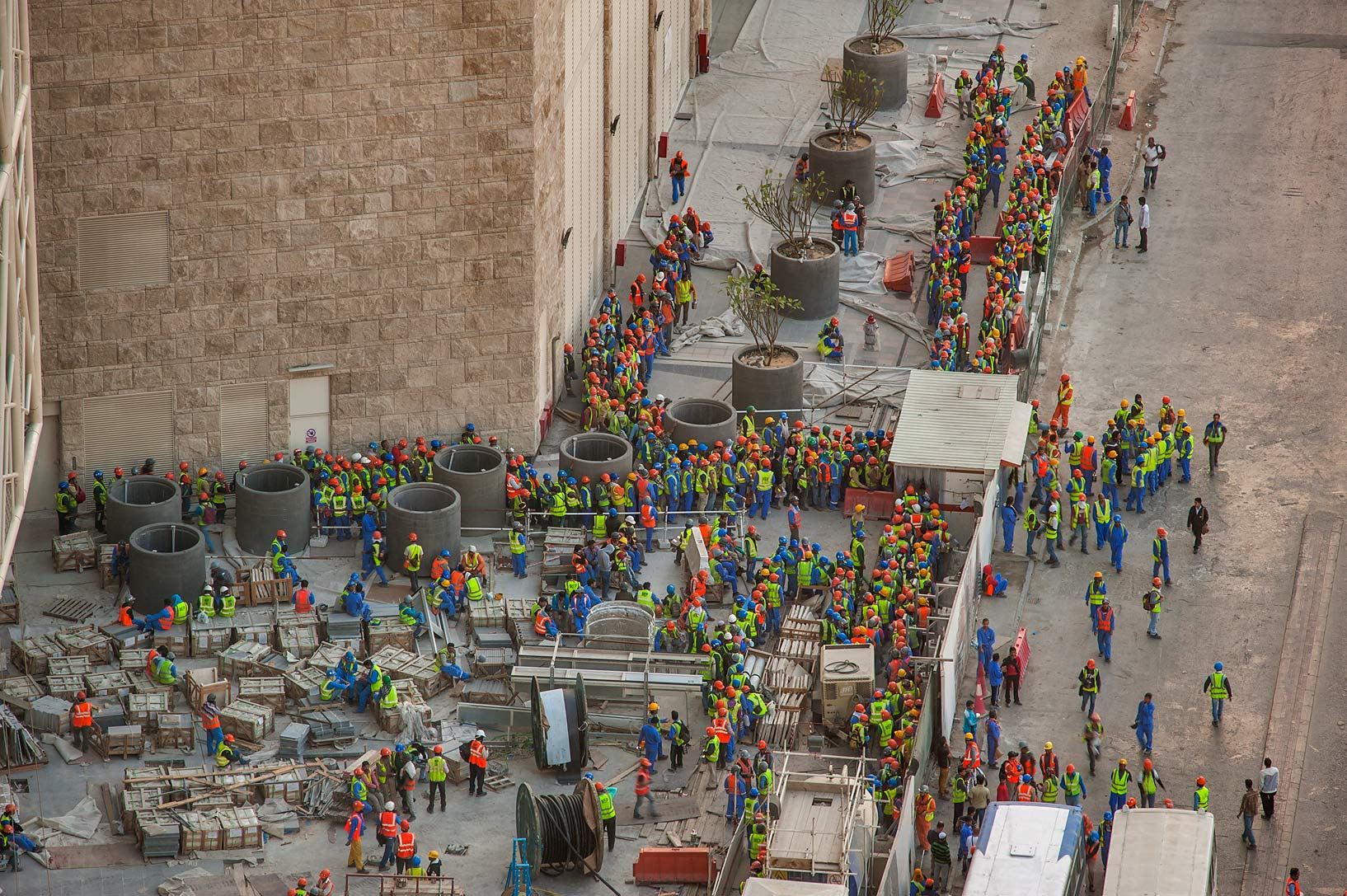 Workers exiting from construction of Qatar...1-2244 of Ezdan Hotel. Doha, Qatar