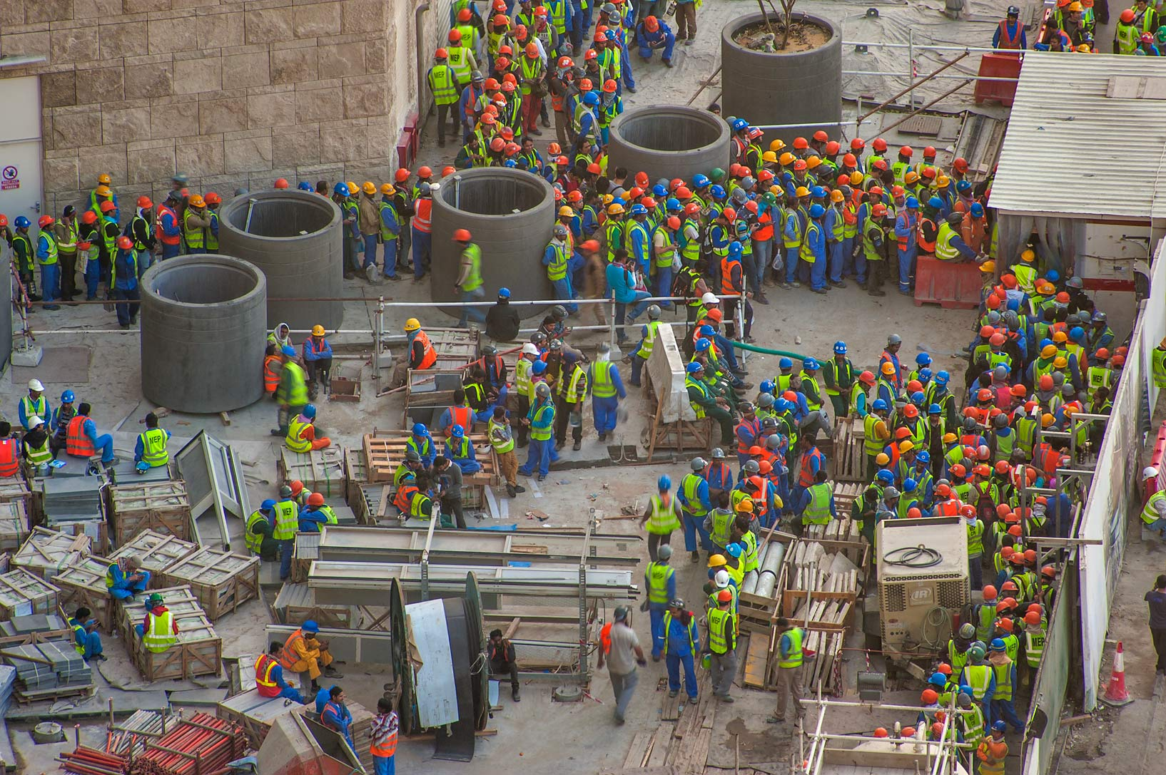 Workers crowding on construction of Qatar...1-2244 of Ezdan Hotel. Doha, Qatar
