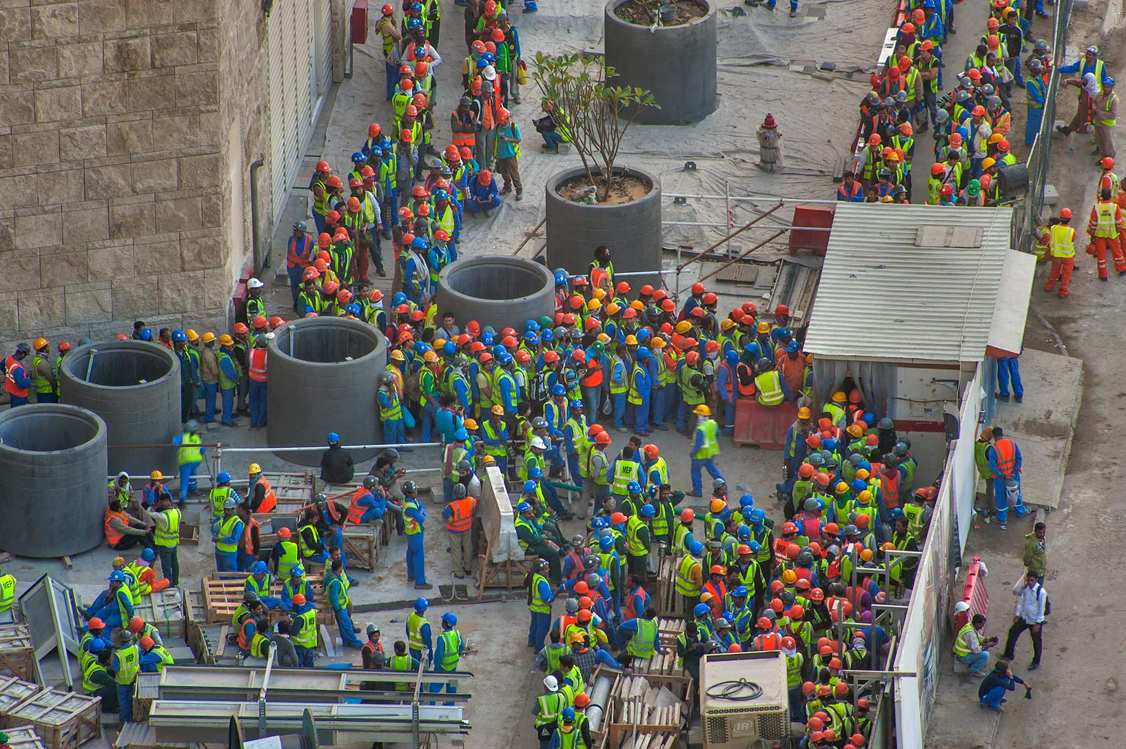 Workers crowding at exit of construction of Qatar...1-2244 of Ezdan Hotel. Doha, Qatar