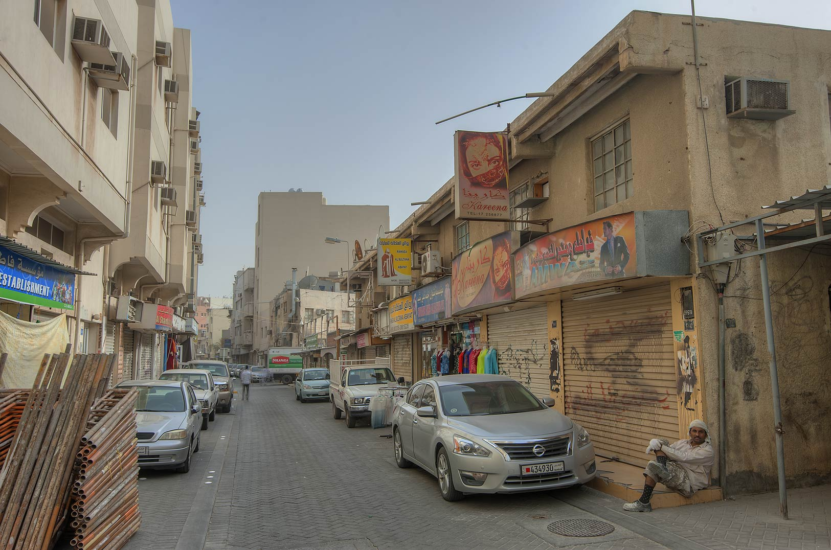 Narrow street in Souq (market) area in Central Manama. Bahrain