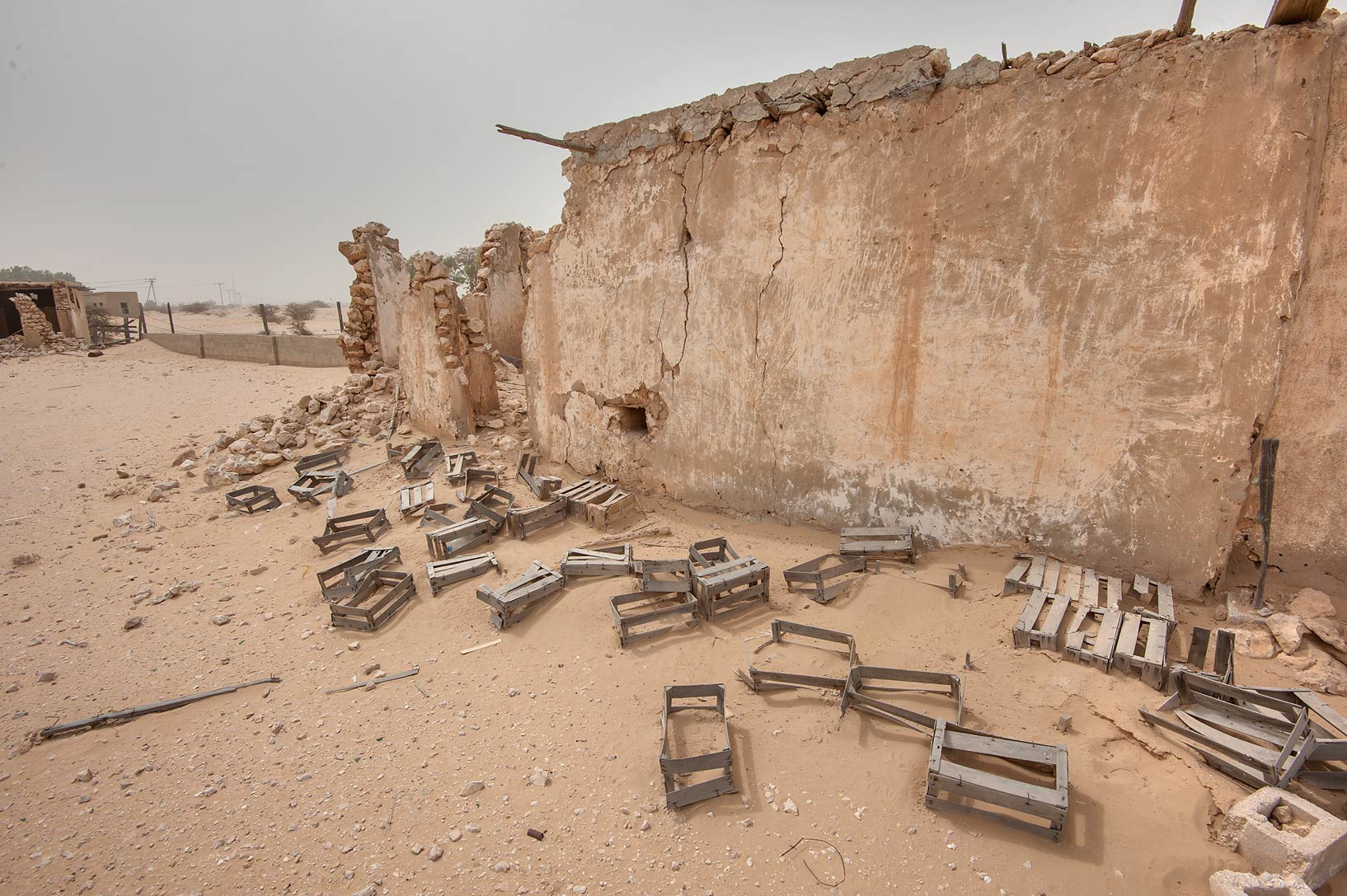 Accumulation of wooden boxes near a mosque near...Jumayliyah (Jamilla, Aljumileh). Qatar