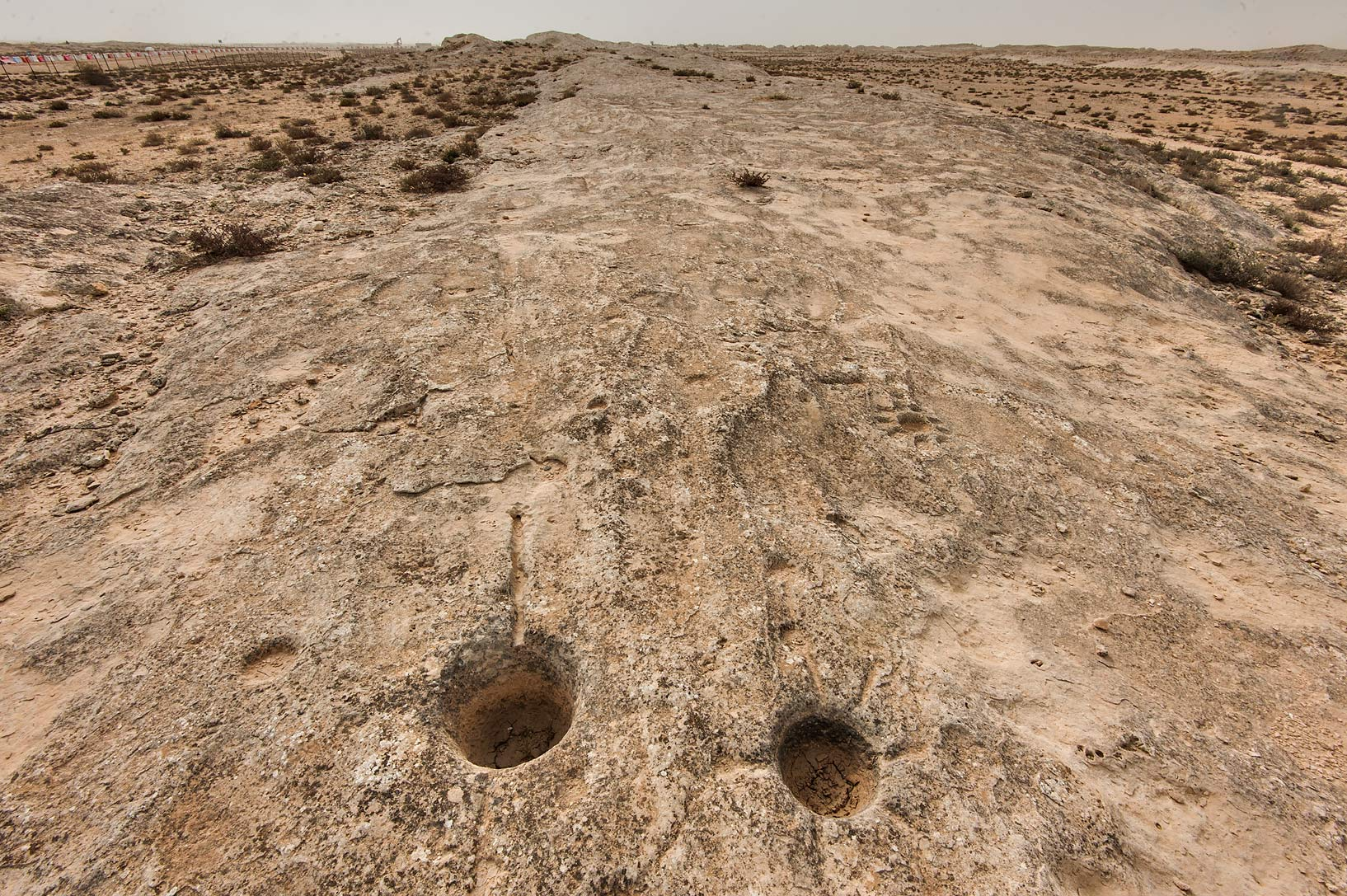 Some round holes on rock carvings (stone...site, on north-eastern coast. Qatar