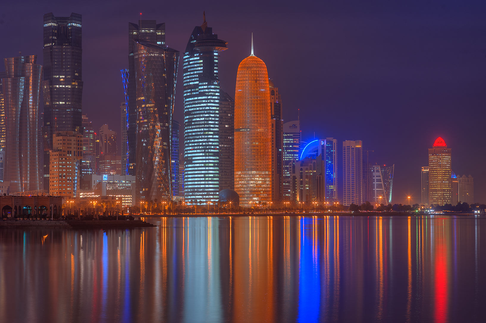 Reflections of West Bay lights from Corniche promenade. Doha, Qatar