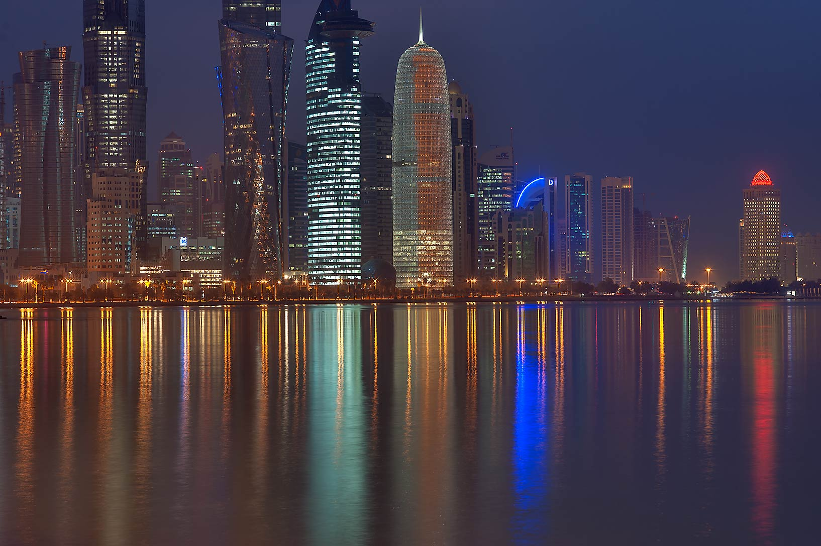 Reflections of West Bay from Corniche promenade at morning. Doha, Qatar