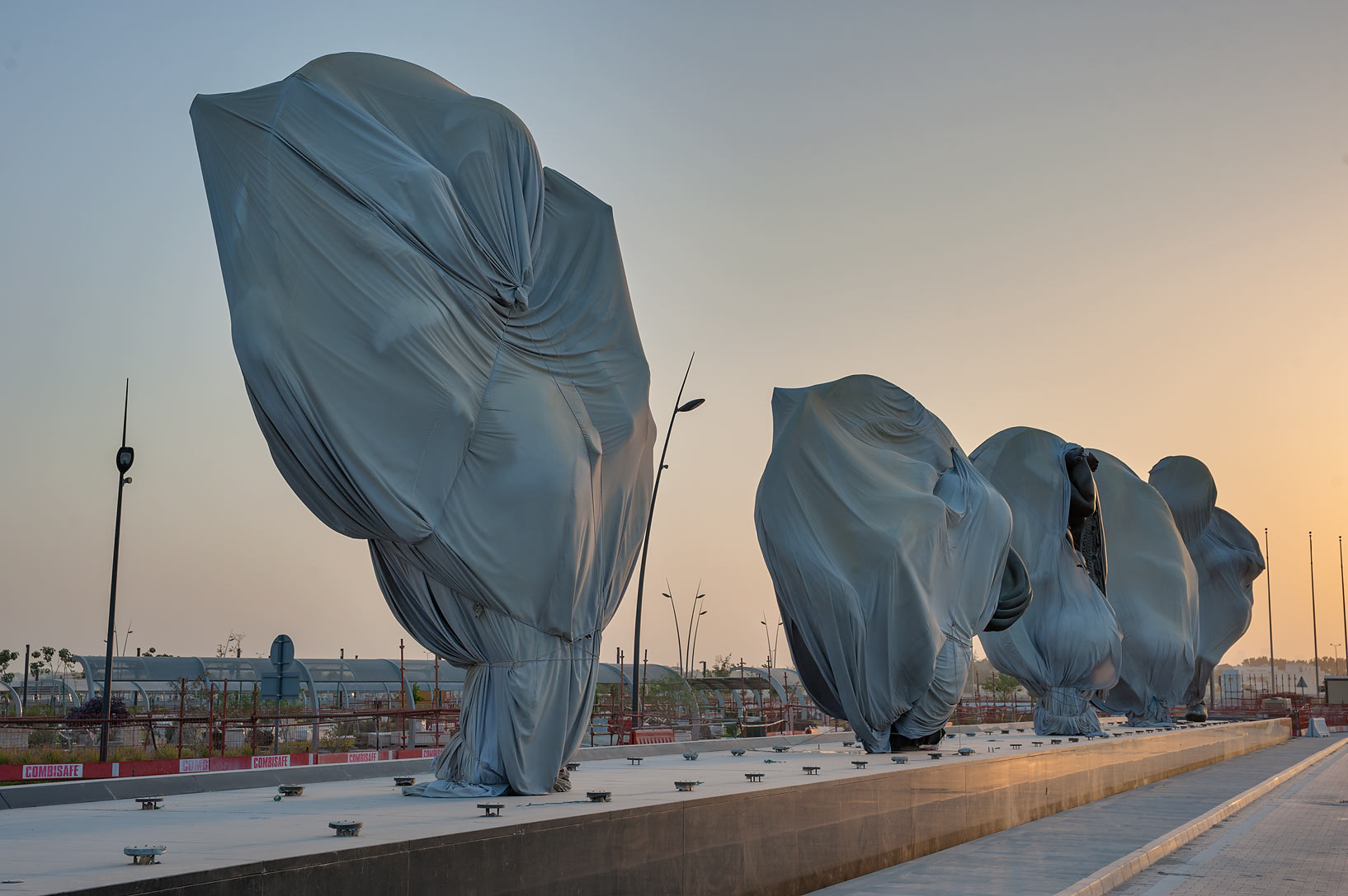 "Dirty bags hiding ""Miraculous Journey"" sculptures...and Research Center. Doha, Qatar"