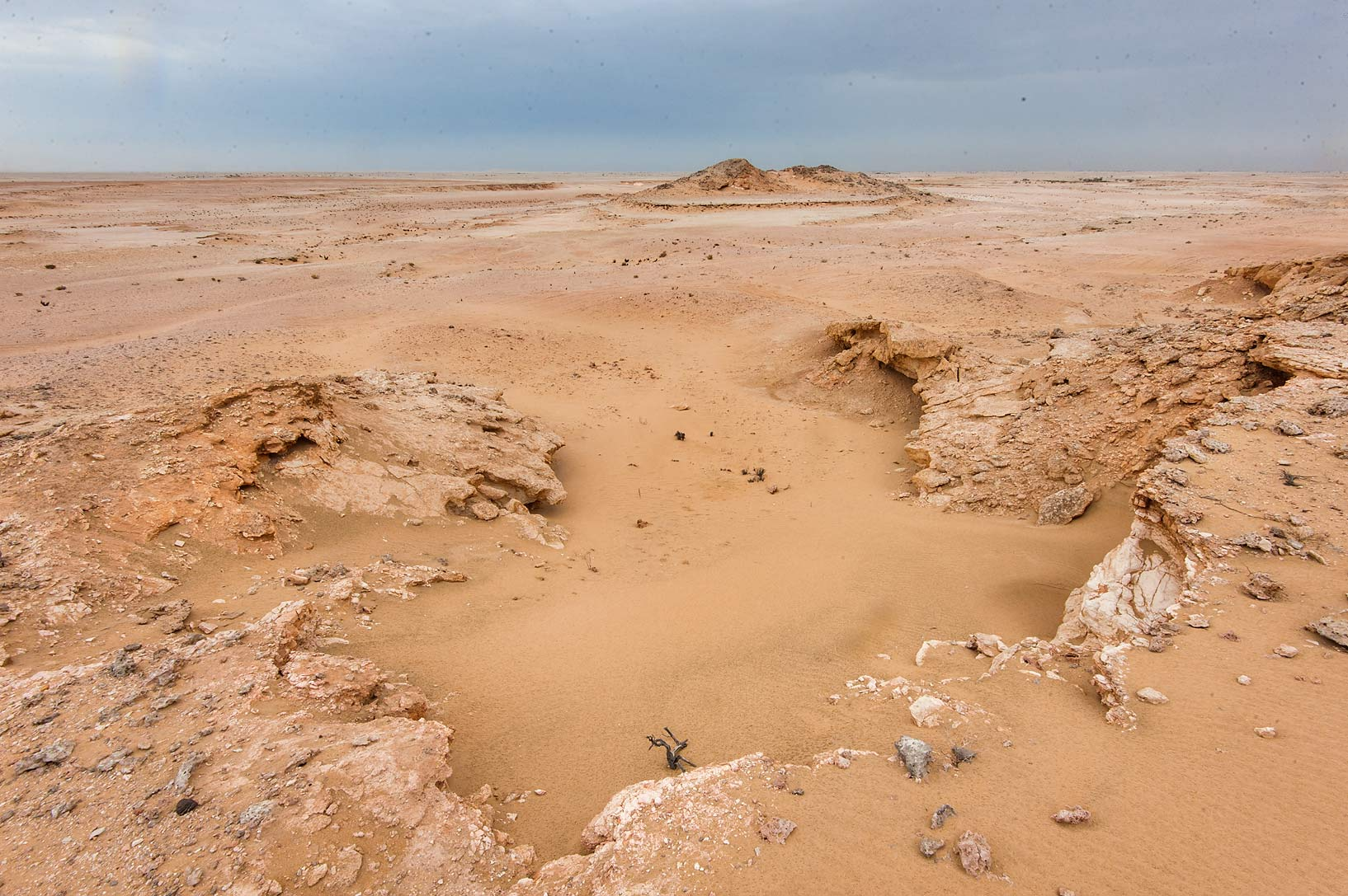 Sandy runnel from a mountain slope in Harrarah (Al Kharrarah). Southern Qatar