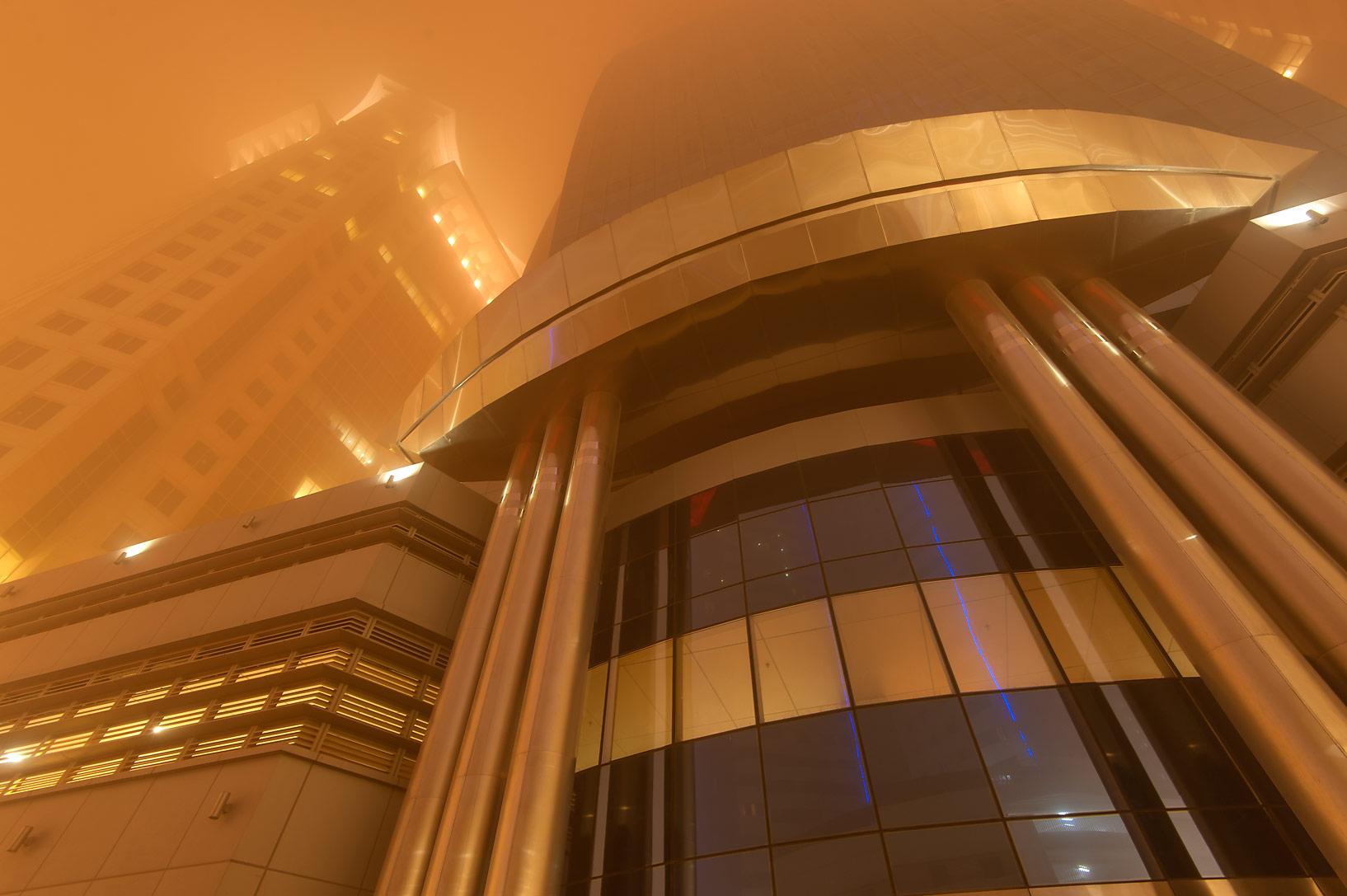 Entrance of Al Huda Engineering Works Tower in West Bay during dust storm. Doha, Qatar