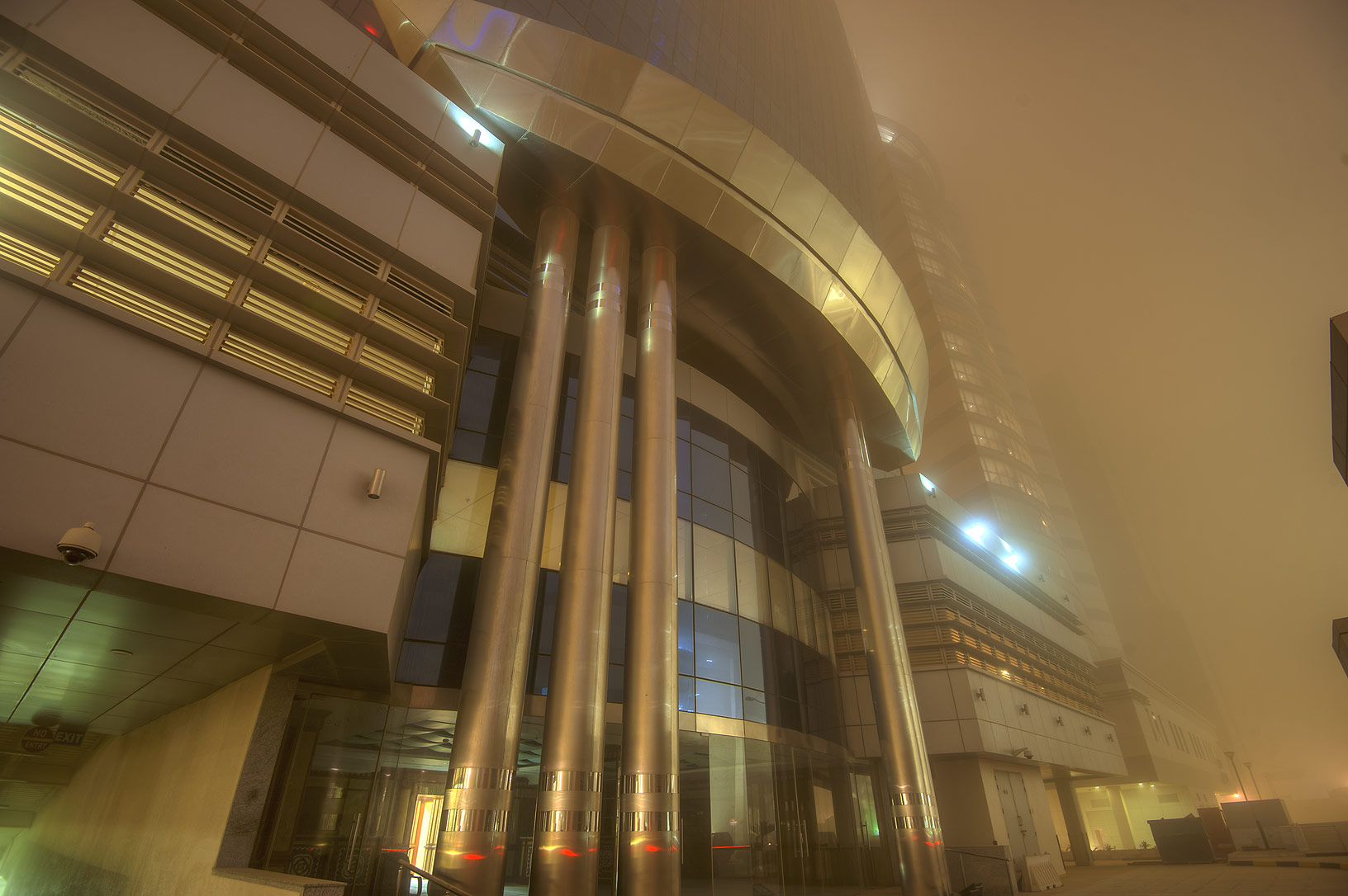 Entrance of Al Huda Engineering Works Tower in...dust storm at morning. Doha, Qatar