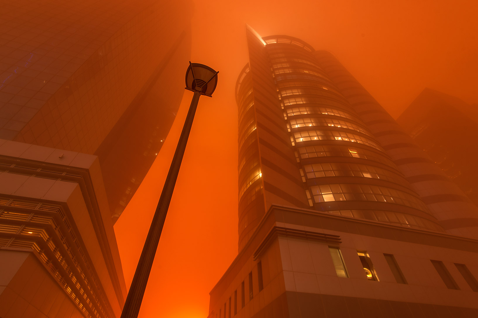 Al Huda Engineering Works and Taawun towers in West Bay during dust storm. Doha, Qatar