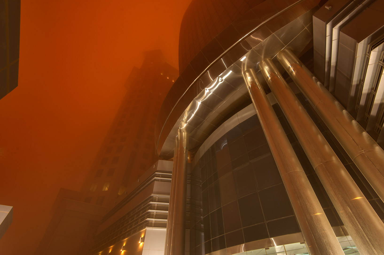 Entrance of Al Huda Engineering Works Tower in West Bay in orange dust. Doha, Qatar