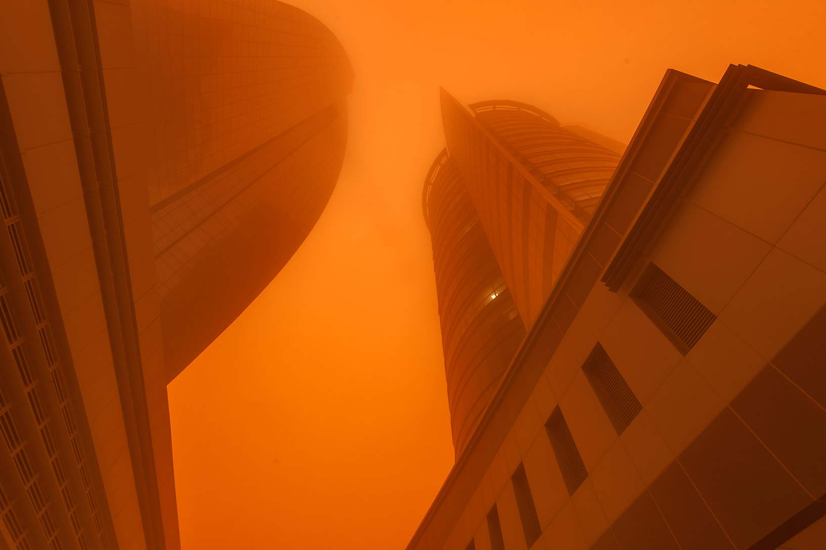 View from the foot of Al Huda Engineering Works...West Bay in orange dust. Doha, Qatar