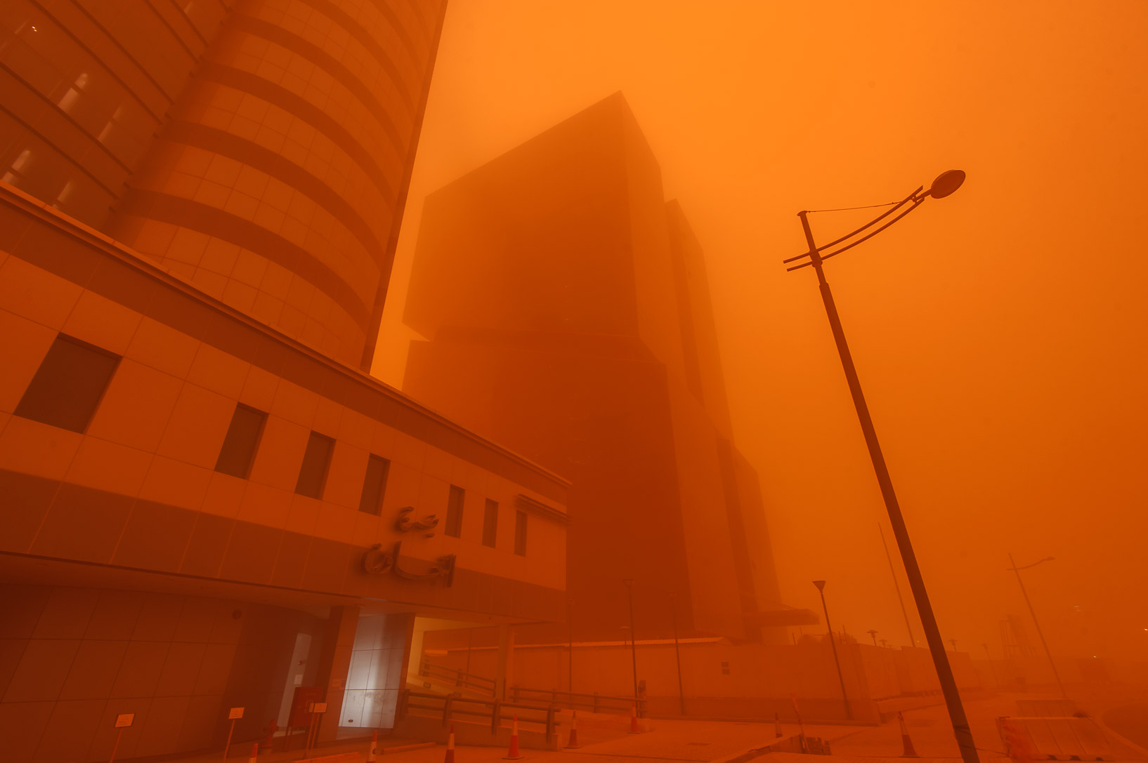 Taawun and Golden Bay towers in West Bay in orange dust. Doha, Qatar