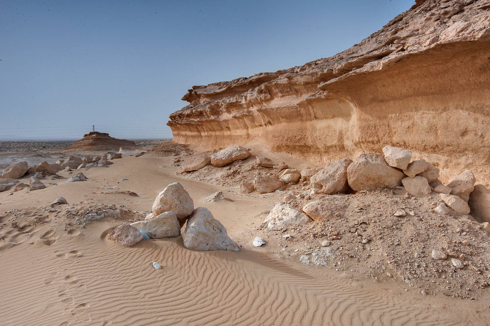 Foot of limestone cliffs near Salwa Rd. in area of Rawdat Ekdaim. Southern Qatar