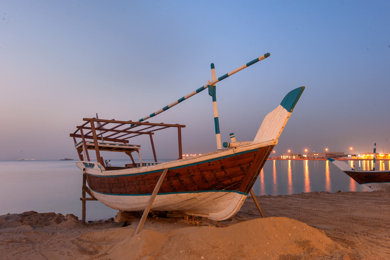 Beached dhow boat at morning in Al Wakra Heritage Village (Souq Waqif in Al Wakrah). Qatar