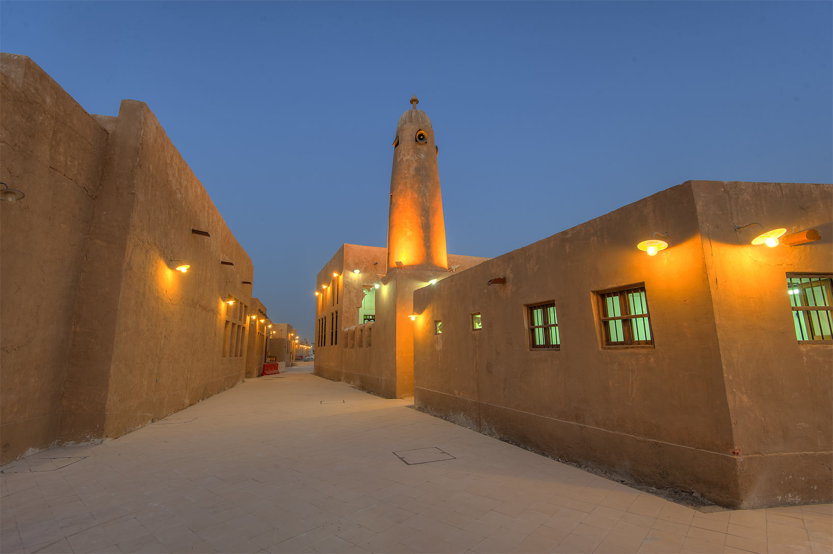 Minaret and stone walls in Al Wakra Heritage Village (Souq Waqif in Al Wakrah). Qatar