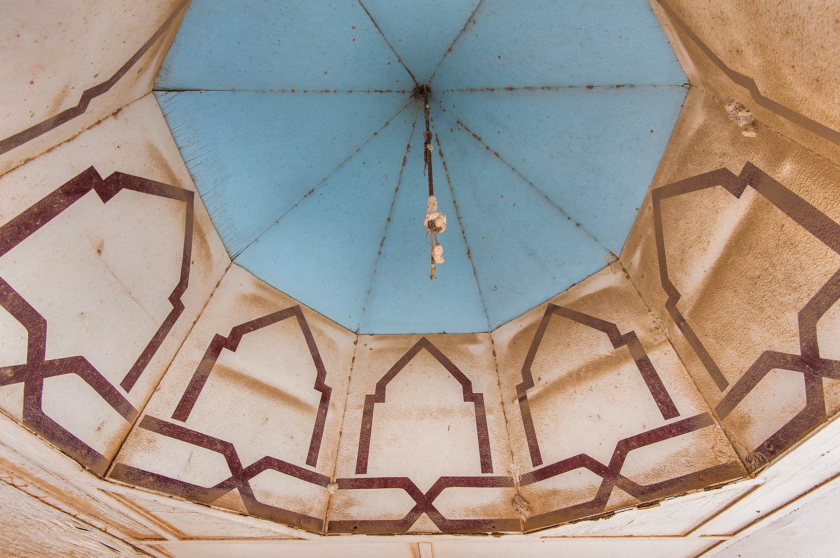 Blue dome and traces of a chandelier in a plywood...jail ponds (sewage lagoons). Qatar