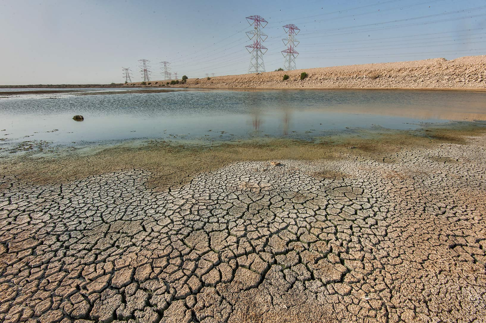 Shrinking water reservoir of Abu Nakhla jail ponds (sewage lagoons). Qatar