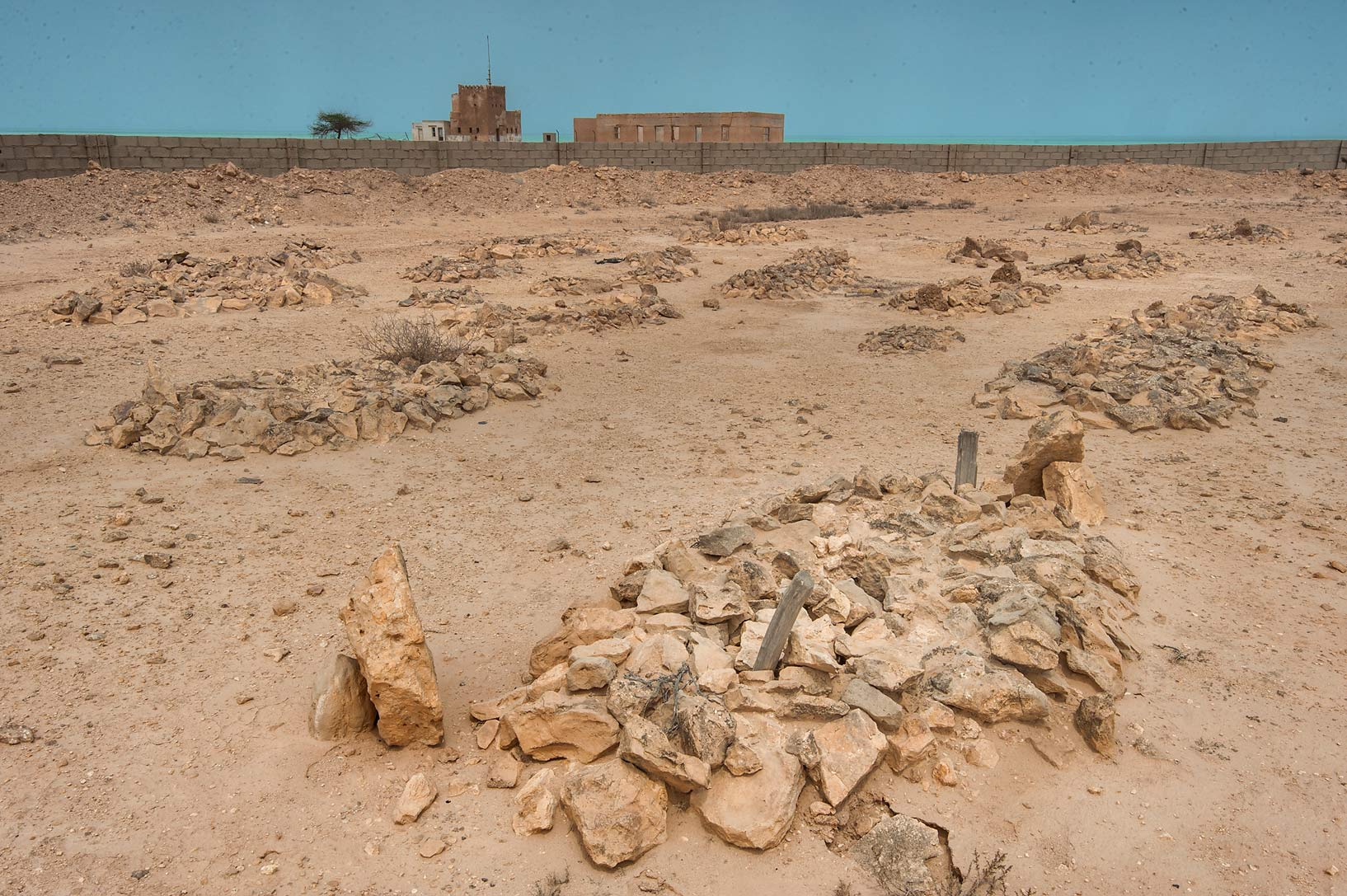 Al Areesh (Arish) Cemetery, with Coast Guard in background. Northern Qatar