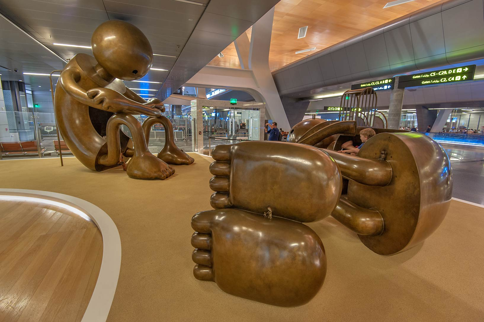 Sitting and laying down figures of Playground...International Airport. Doha, Qatar