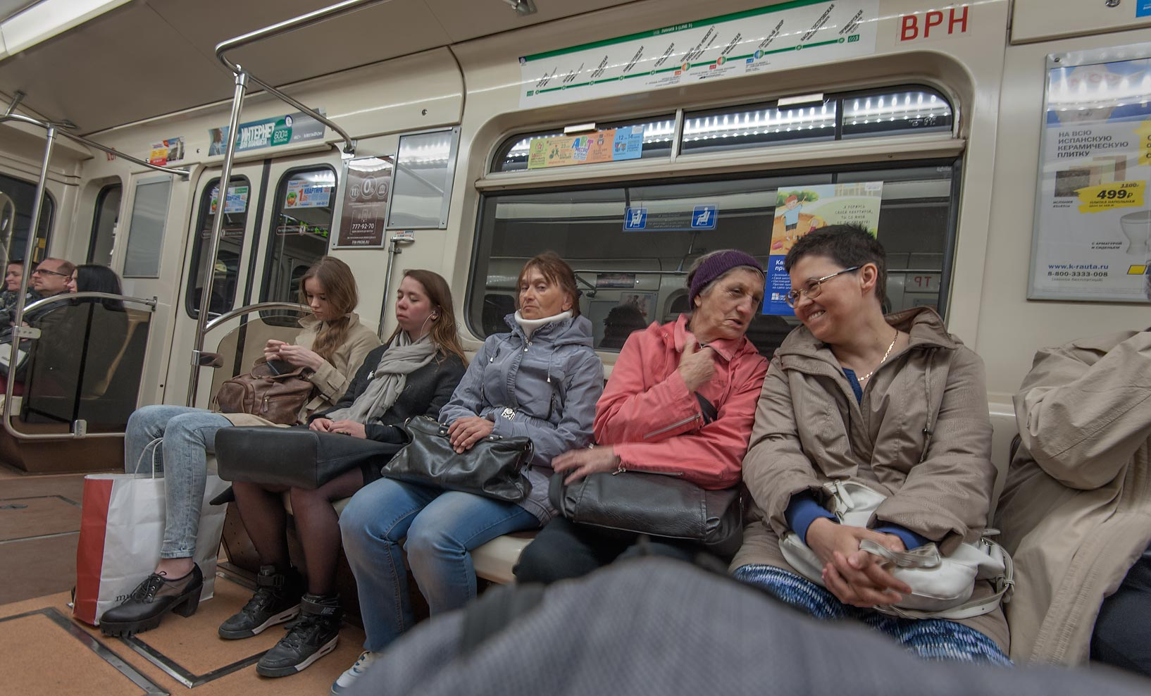 Passengers in a train of subway (metro). St.Petersburg, Russia